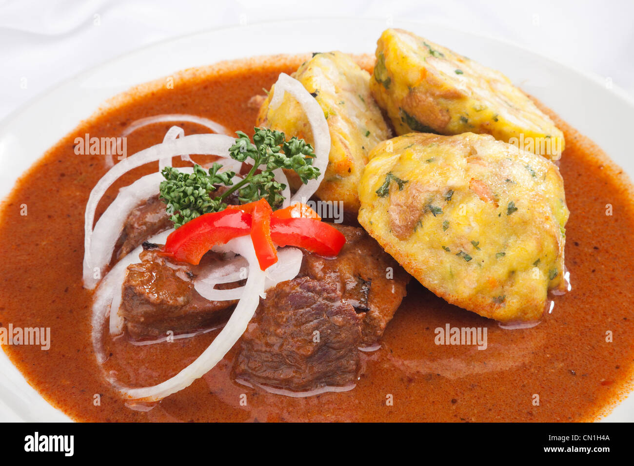 Hungarian Goulash W Dumplings And Vegetable Garnish Stock Photo Alamy