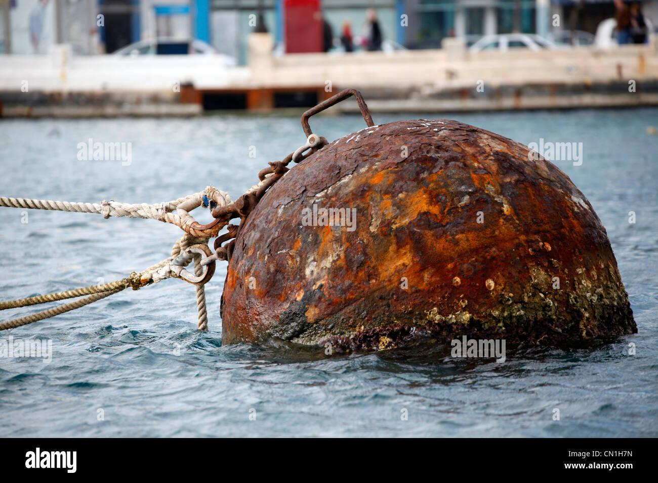 Rusty buoy floating in Valletta harbour, Valletta, Malta Stock Photo