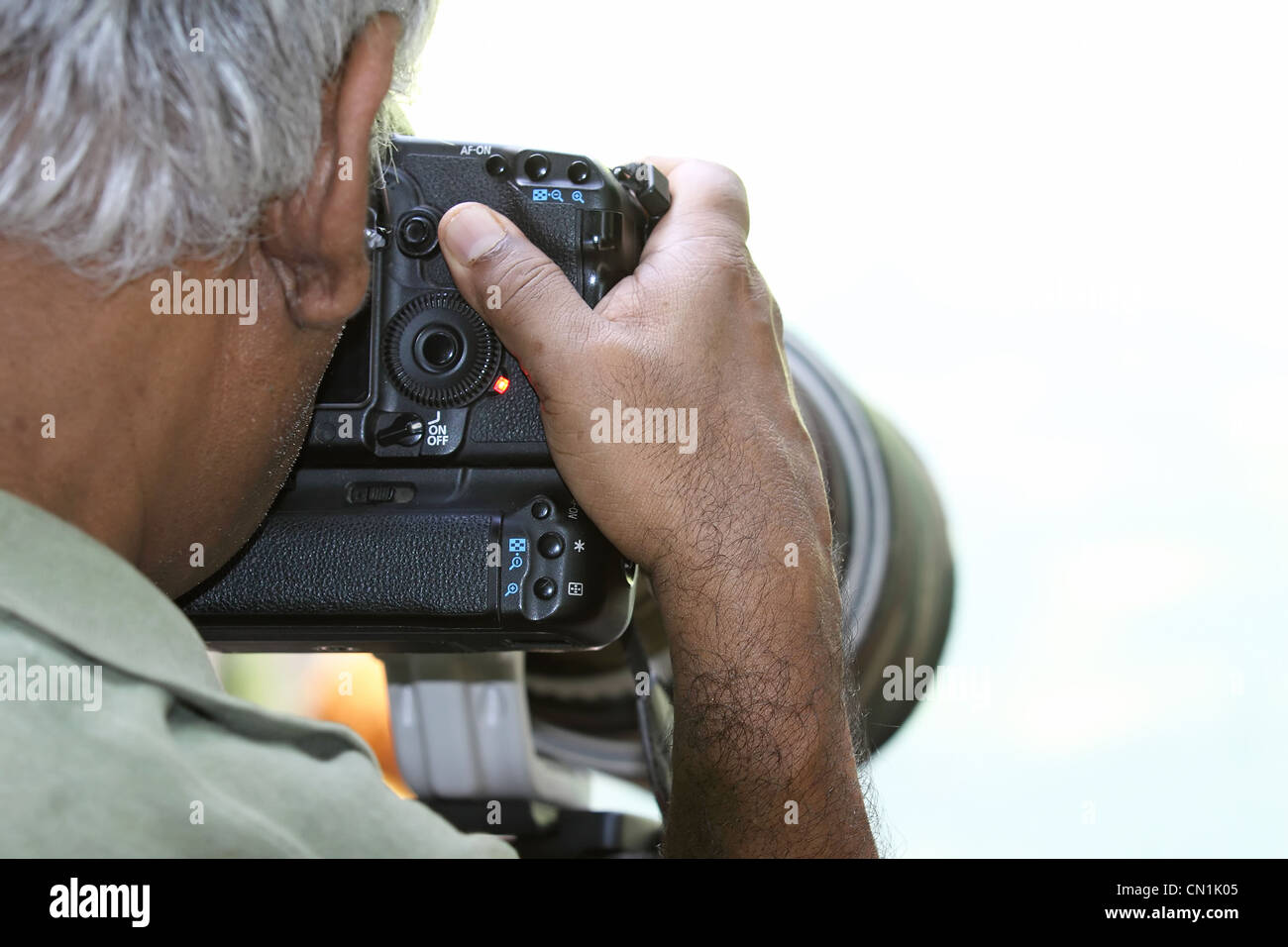 Photographer at Work - Stock Image