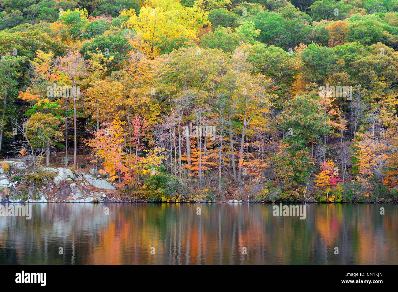 Bear Mountain with Hudson River in Autumn with colorful foliage and water reflection. - Stock Image
