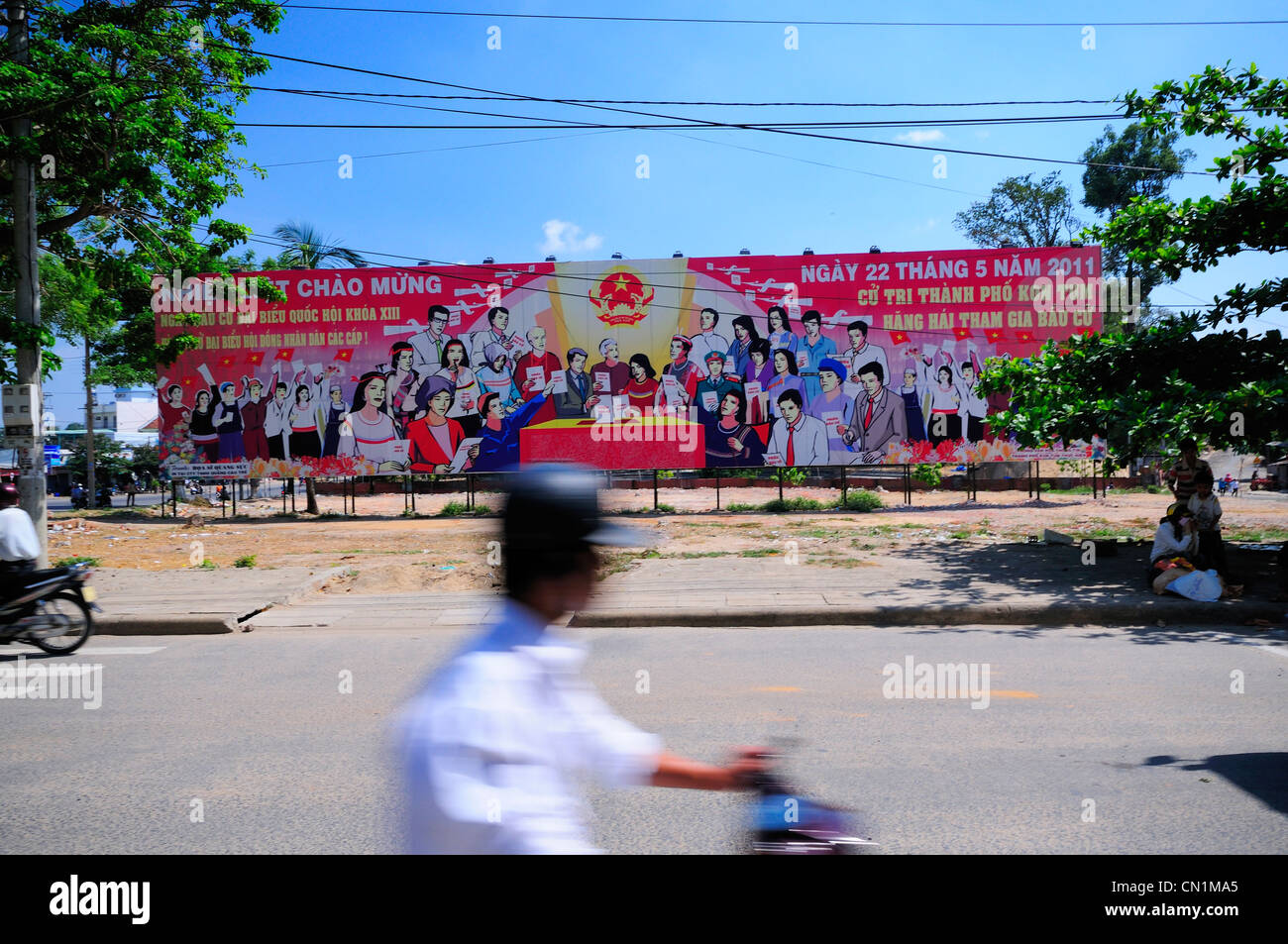 Communist billboard encouraging people to vote n forthcoming elections. Kon Tum, North Central Highlands, Vietnam - Stock Image