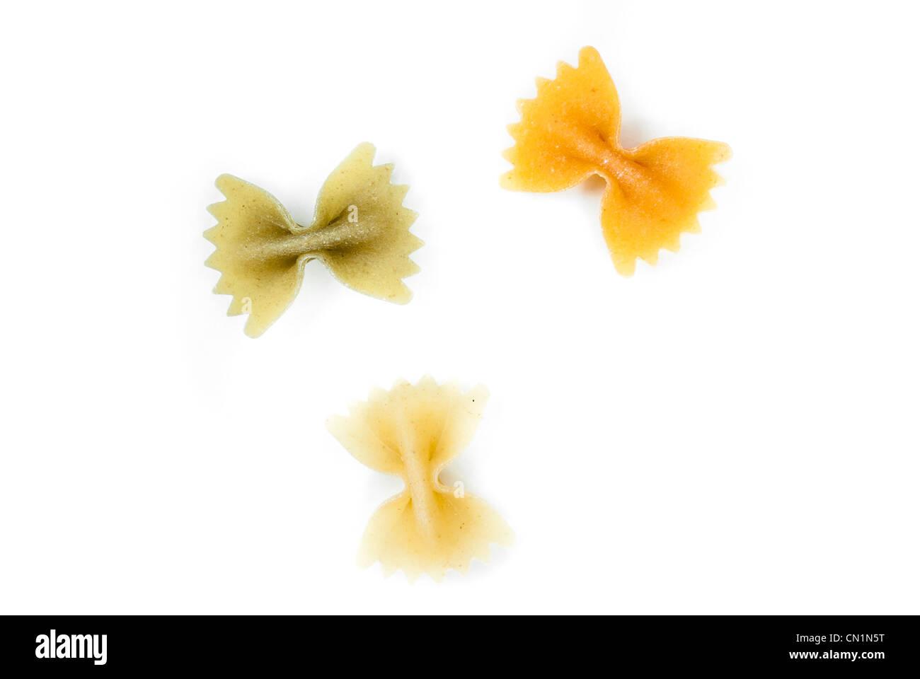 Farfalle pasta on a white background - Stock Image