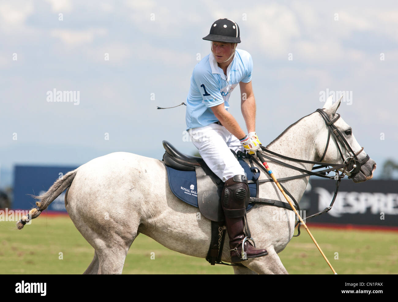 Britain's Prince Harry takes part in the Sentabele charity polo match during his visit to Brazil in March 2012 - Stock Image