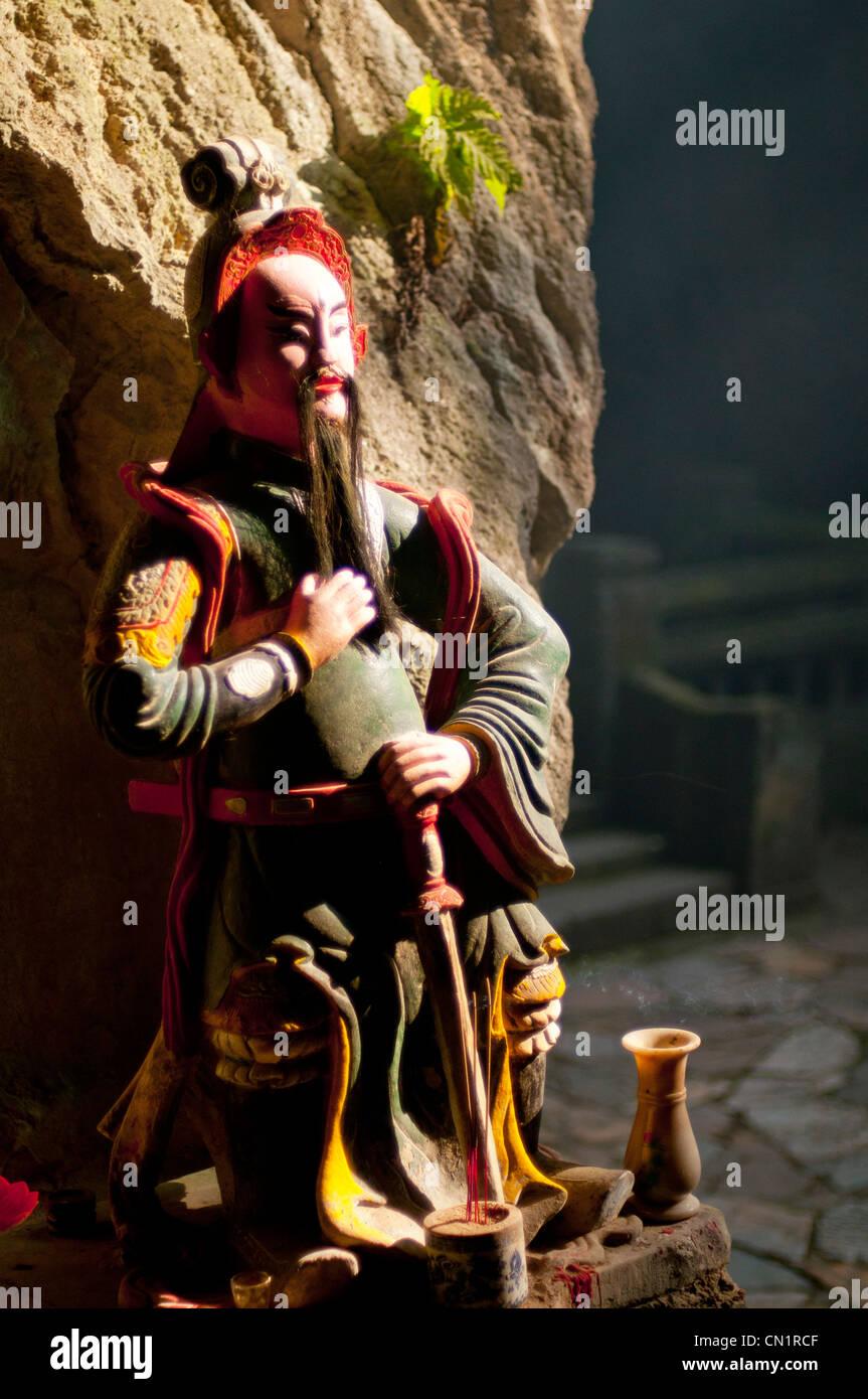 Staue guarding Tang Chon Dong Caves. Marble Mountains, Danang, Vietnam - Stock Image