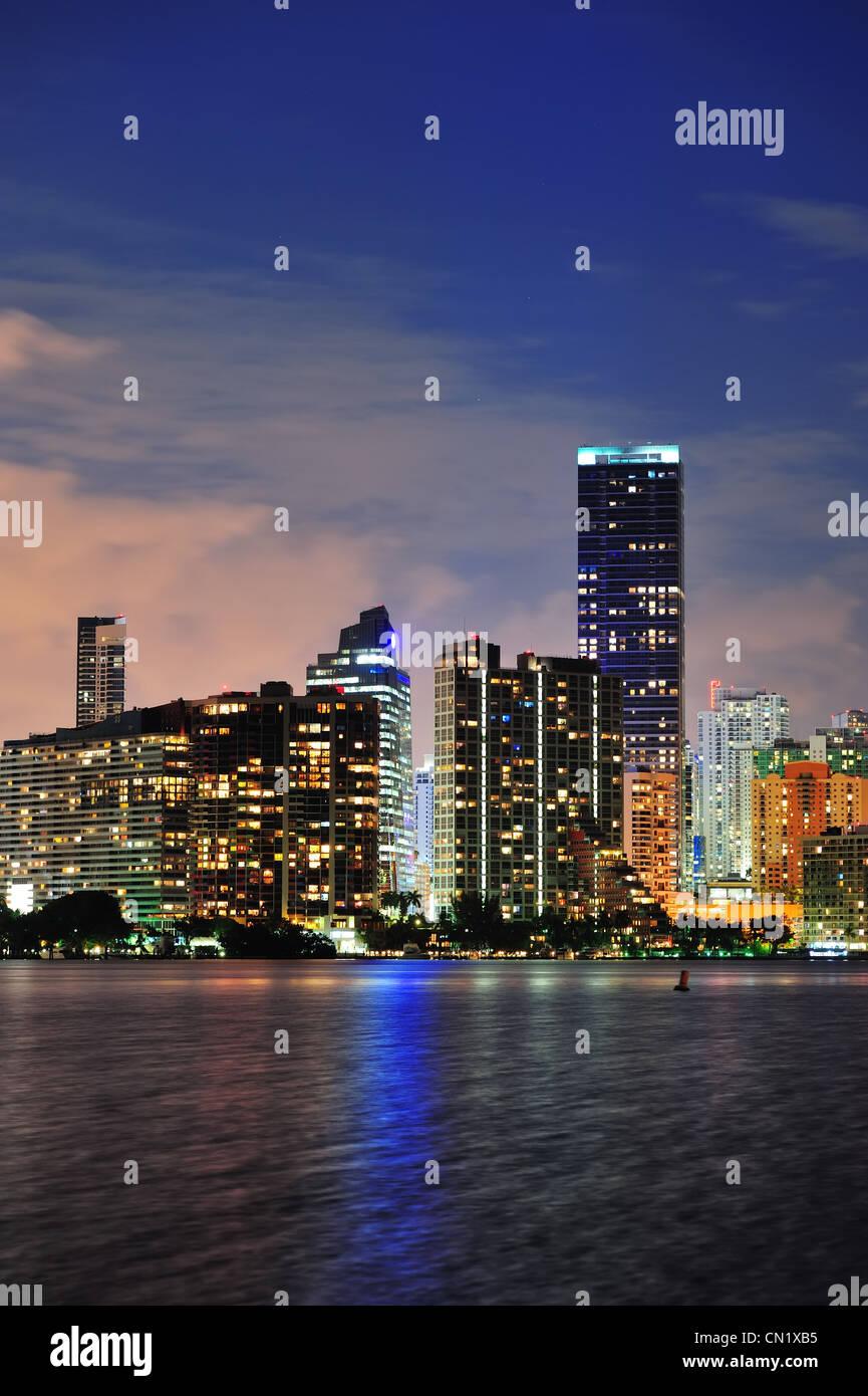 Miami urban architecture closeup over sea at night. - Stock Image