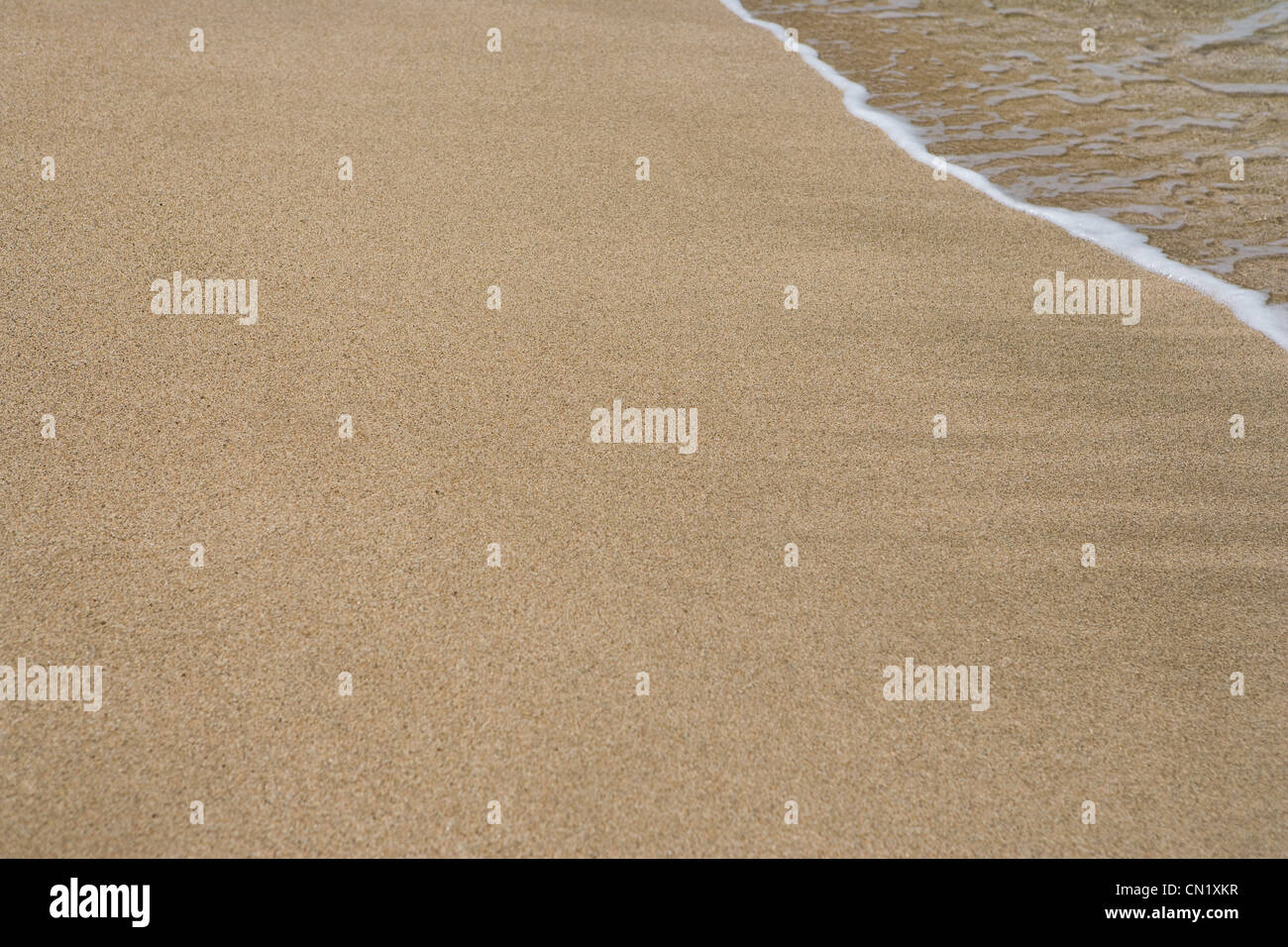 Surf on sand, Kauai, Hawaii - Stock Image