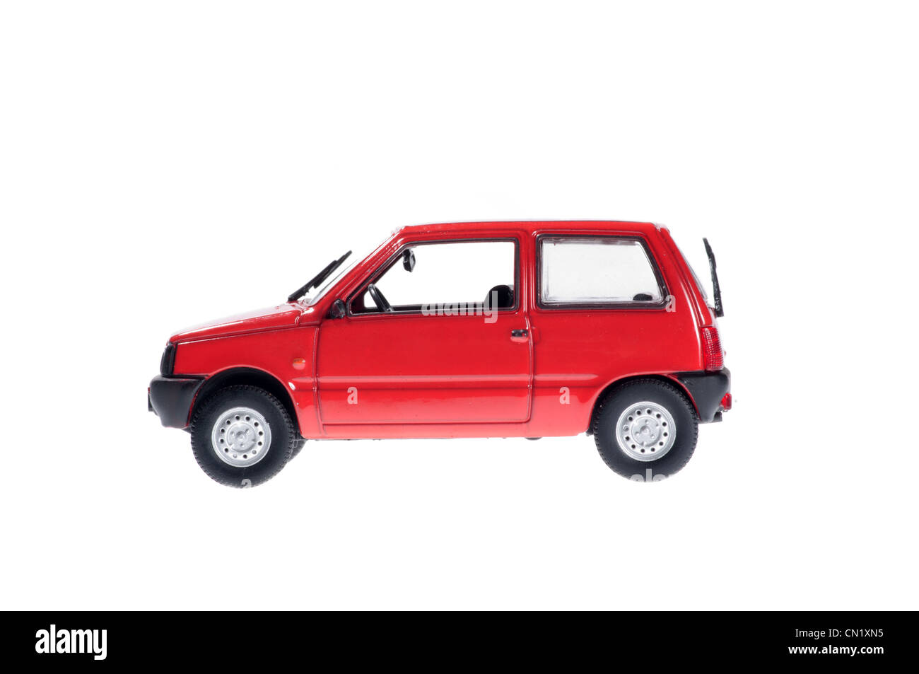 Small red car on white background. - Stock Image