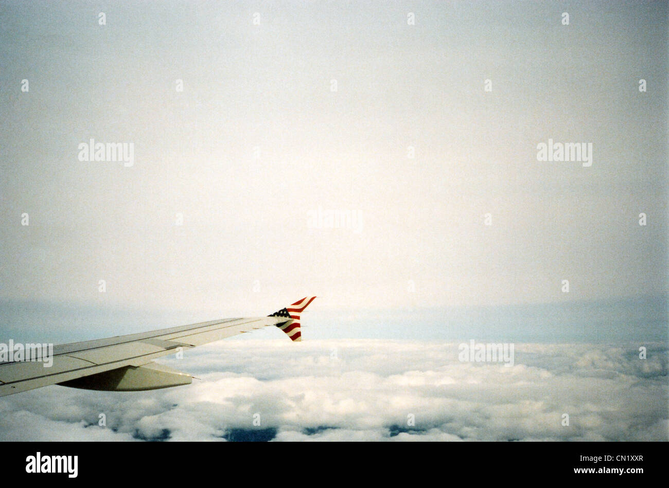Airplane wing with US flag - Stock Image