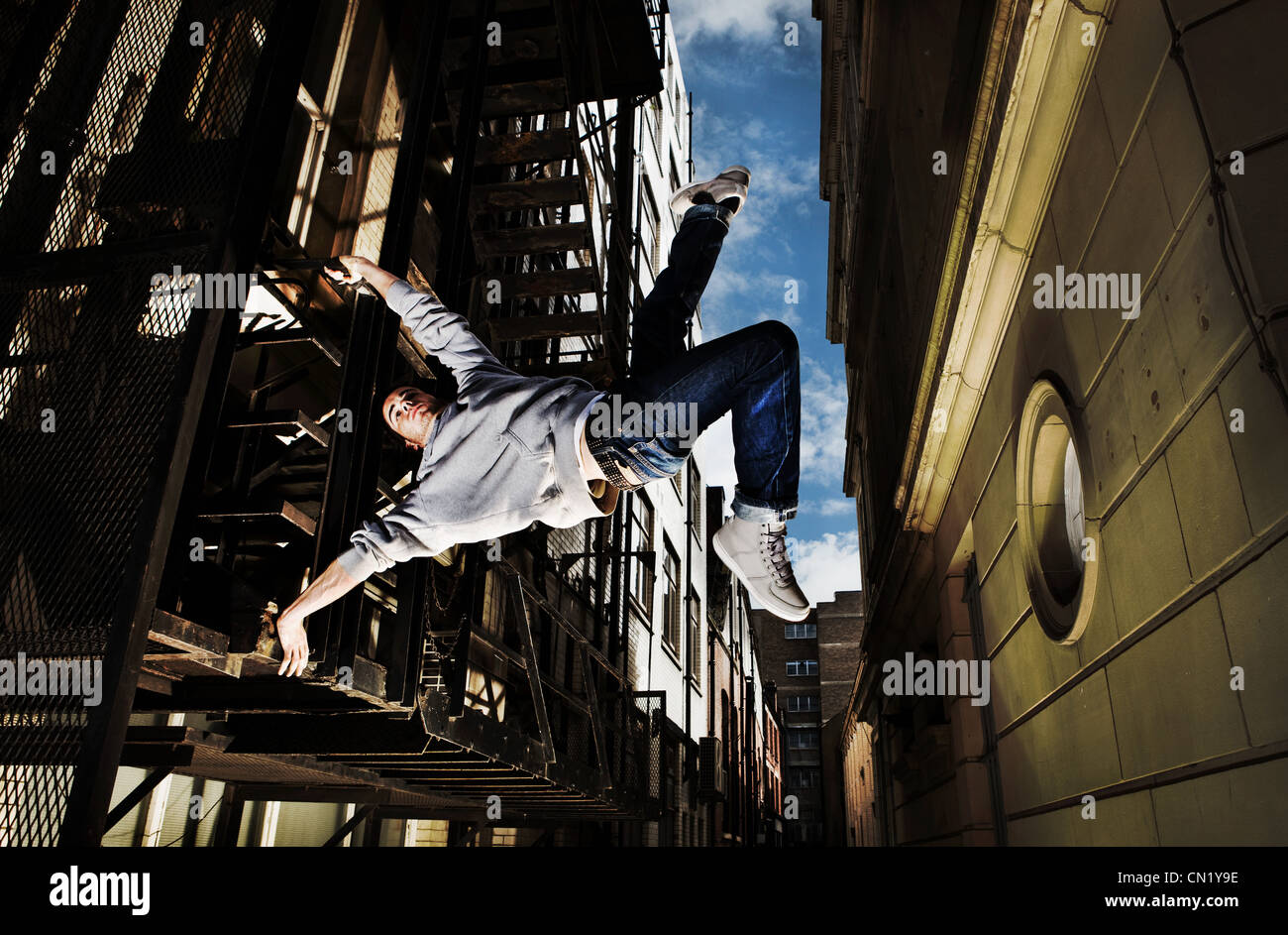 Young man breakdancing - Stock Image