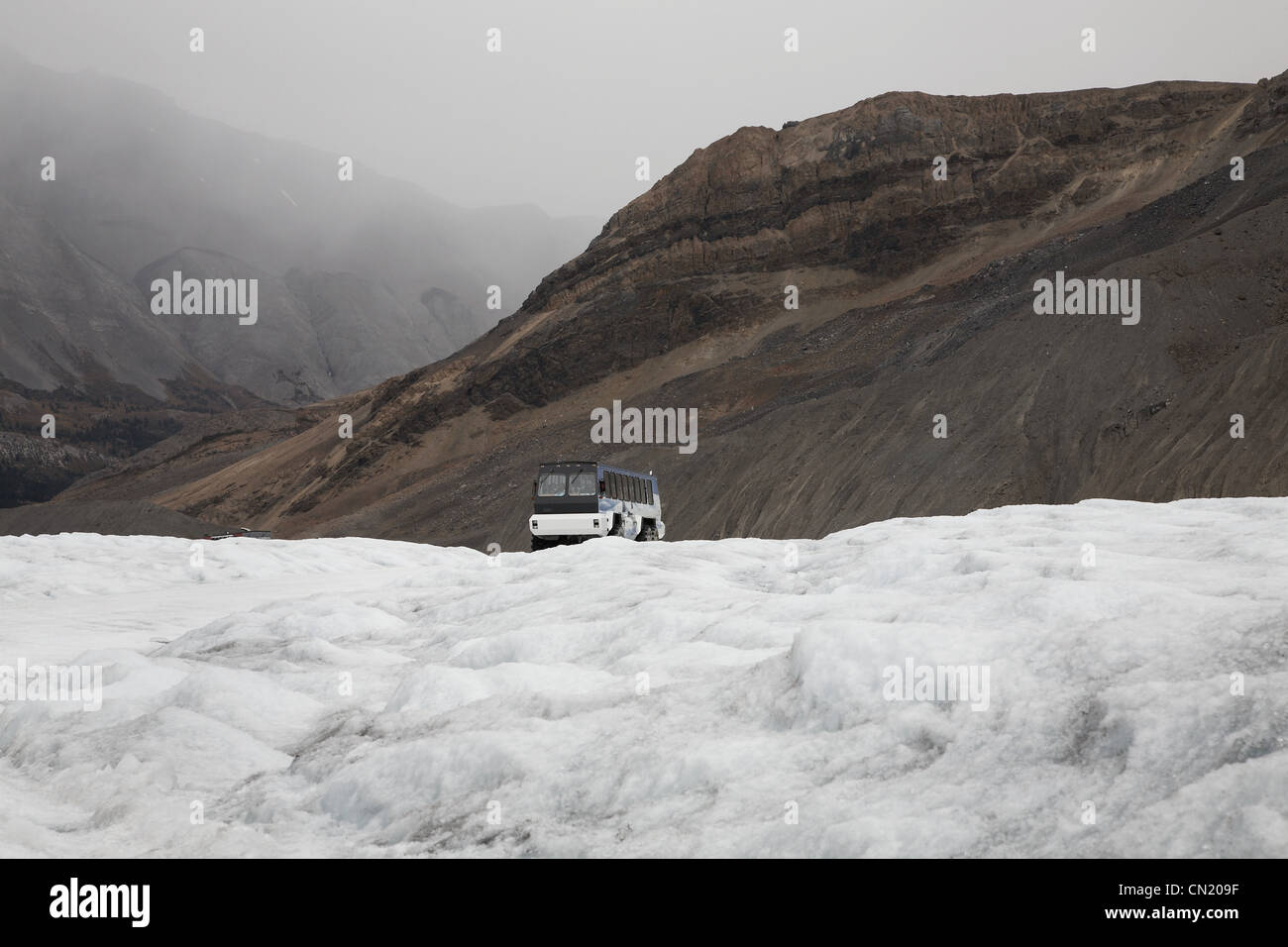 Snowmobile on glacier, Canada - Stock Image