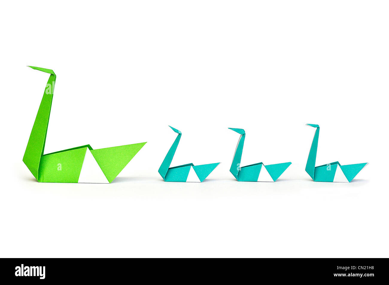 Origami Swan Stock Photos Images Alamy Pics Diagrams Green Paper Leading Three Small Baby Swans Image