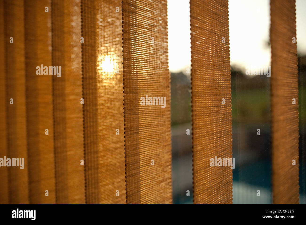 Window blinds at sunset - Stock Image