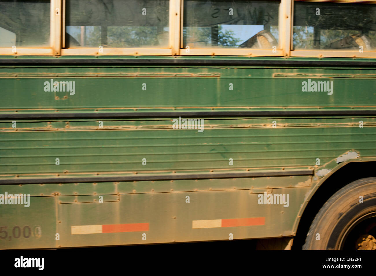 Dusty green bus, side view - Stock Image