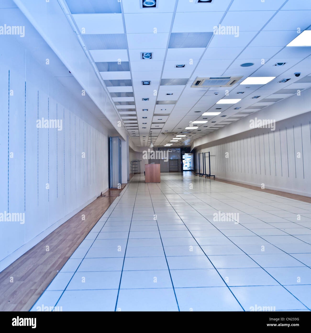 Interior, empty high street shop closed down retail outlet UK - Stock Image