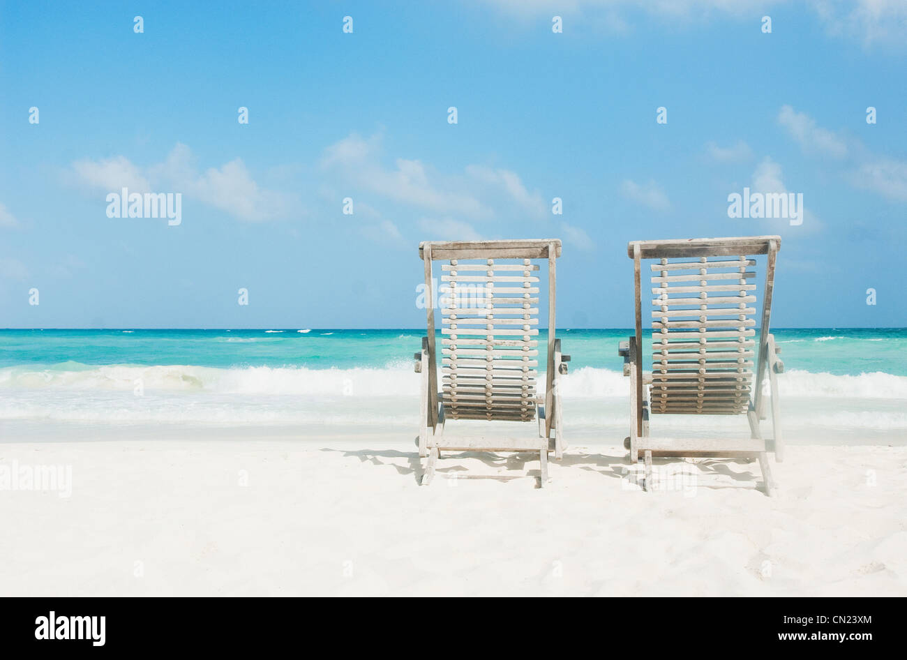 Two sun loungers on beach, Tulum, Mexico - Stock Image