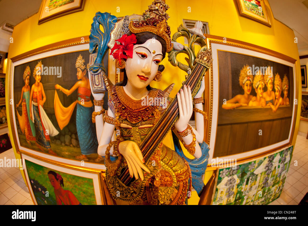 Painted statue in an art gallery Bali Indonesia - Stock Image
