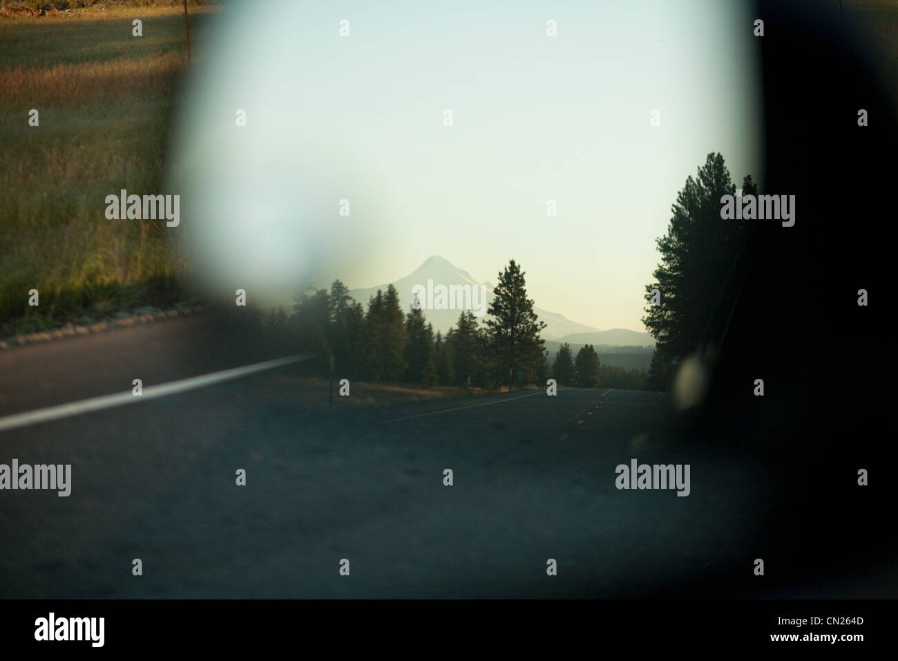Mount Hood seen in car mirror, Portland, Oregon - Stock Image
