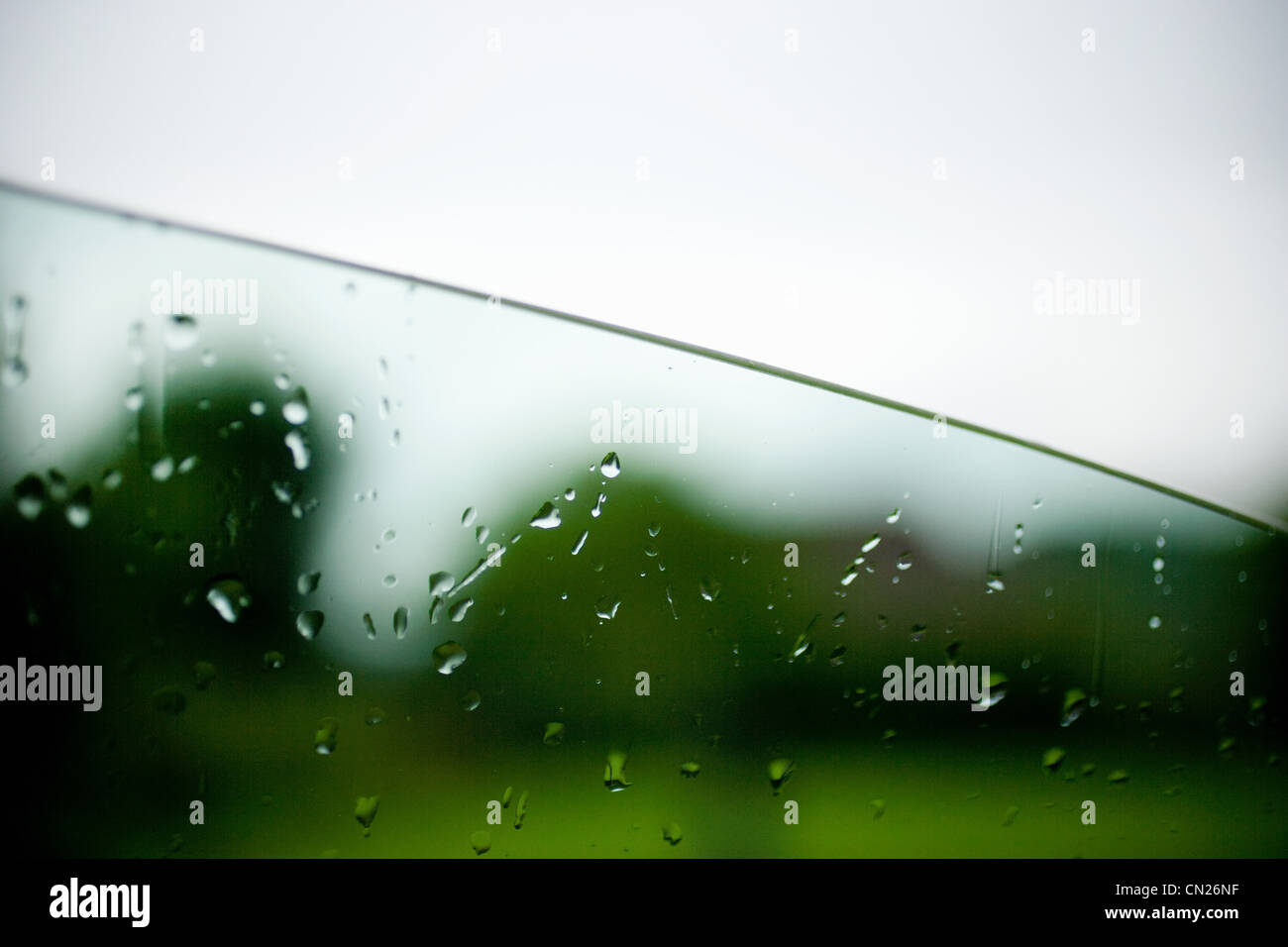 Raindrops on car window - Stock Image