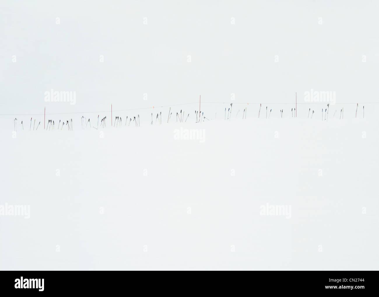 Ski poles in the snow, Lake Tahoe, California, USA - Stock Image