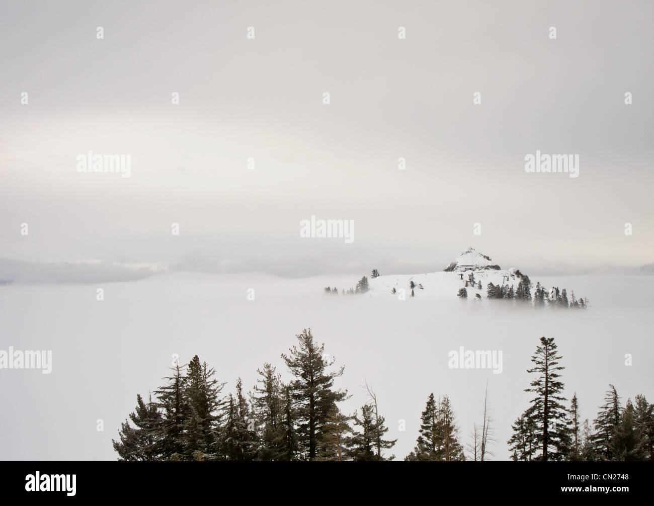 Snow capped mountain in the fog, Lake Tahoe, California, USA - Stock Image
