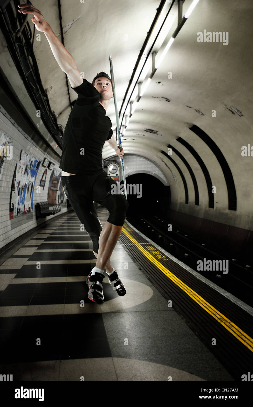 Javelin thrower in London Underground tunnel - Stock Image
