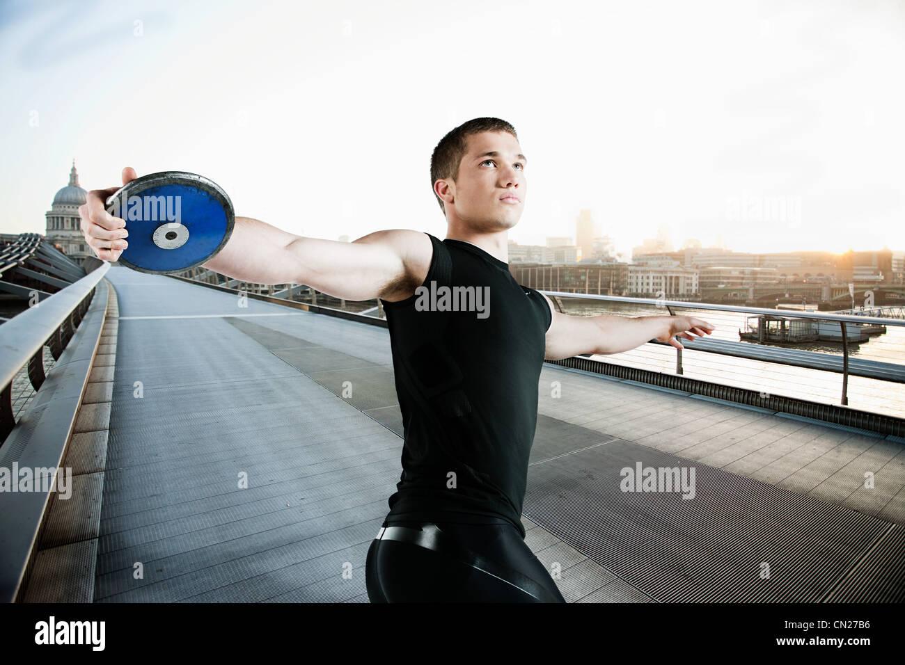 Discus thrower on Millennium Bridge, London, England - Stock Image
