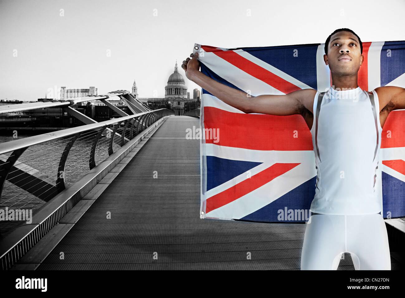 Olympic competitor on Millennium Bridge, London, England - Stock Image