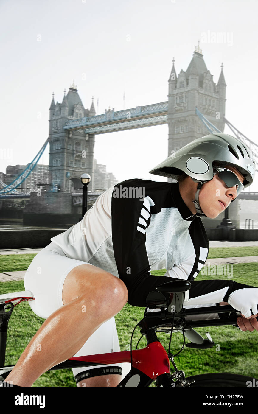 Cyclist with Tower Bridge in background, London, England Stock Photo