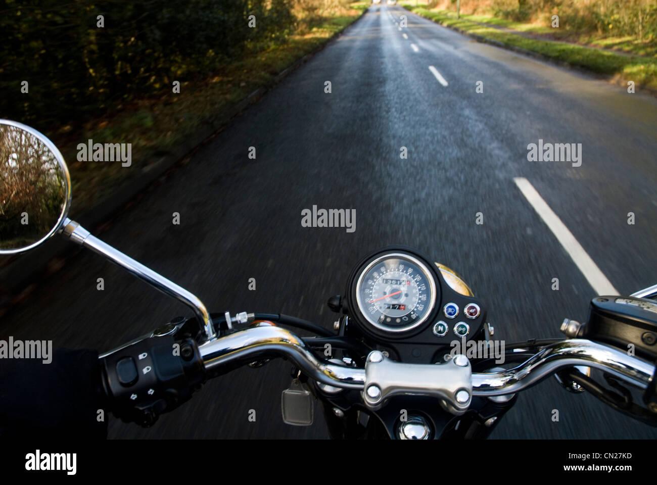 Motorbike on empty rural road - Stock Image