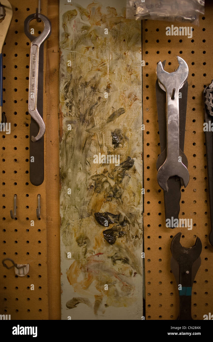 Spanners hanging up in workshop - Stock Image