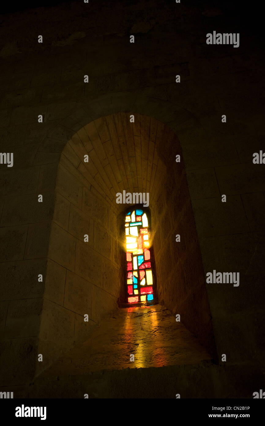 Stained glass window in church - Stock Image