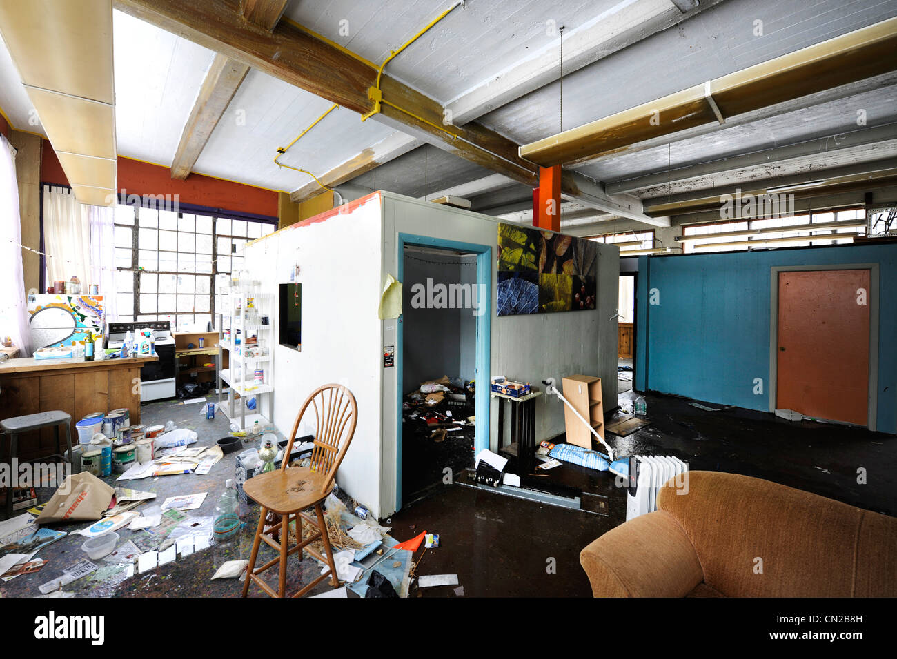 Industrial building sold in bankruptcy auction.  Unused for years, it was looted, vandalized, and occupied by squatters. - Stock Image