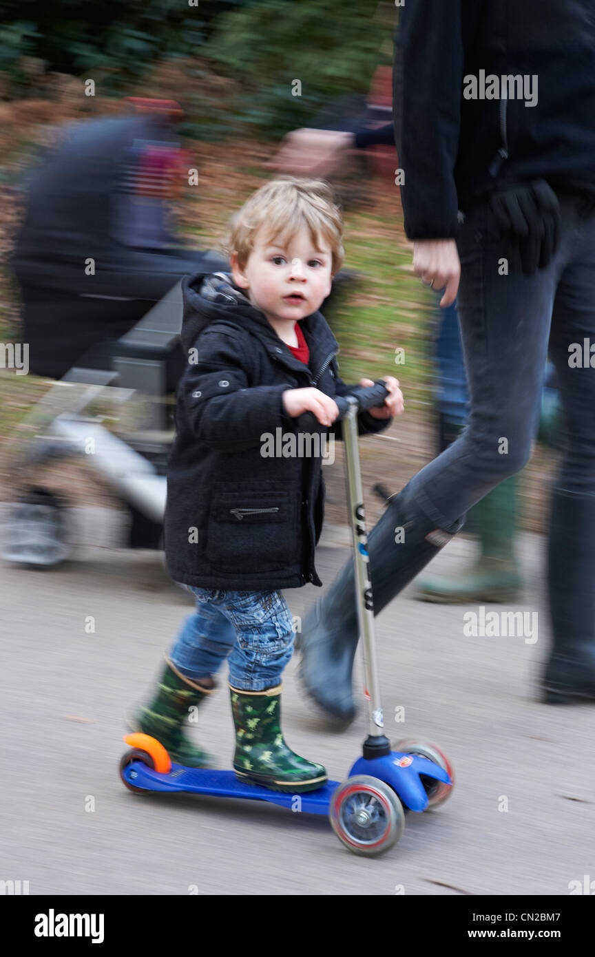 Boy on scooter - Stock Image
