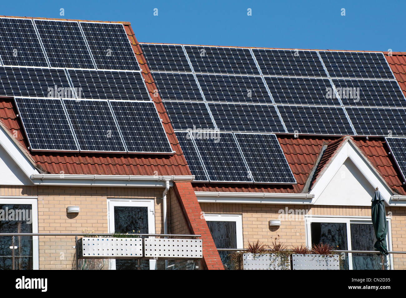 solar panels on house roof - Stock Image