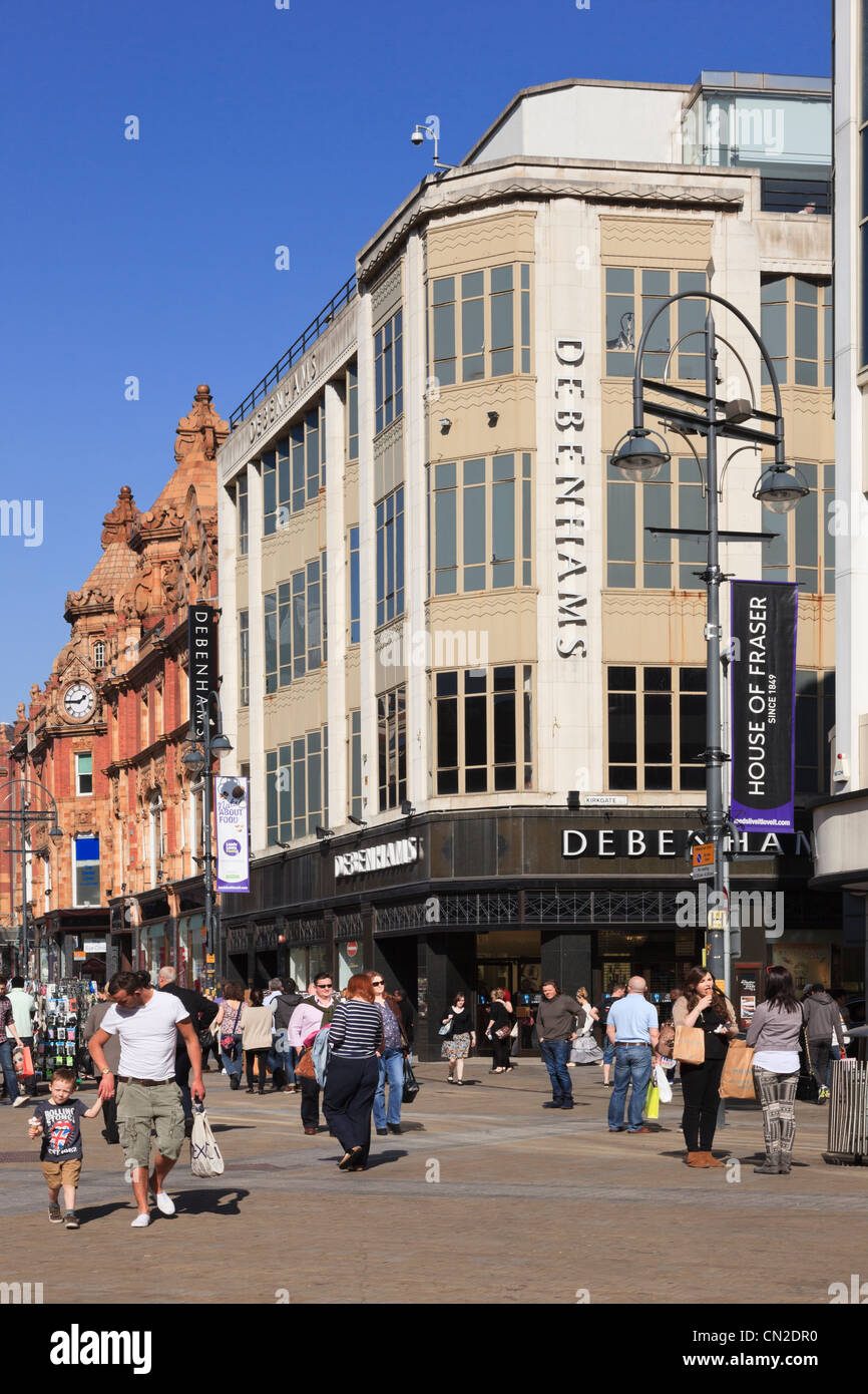 Briggate Leeds Yorkshire England UK. Busy street scene with people shopping in city centre outside Debenhams department - Stock Image