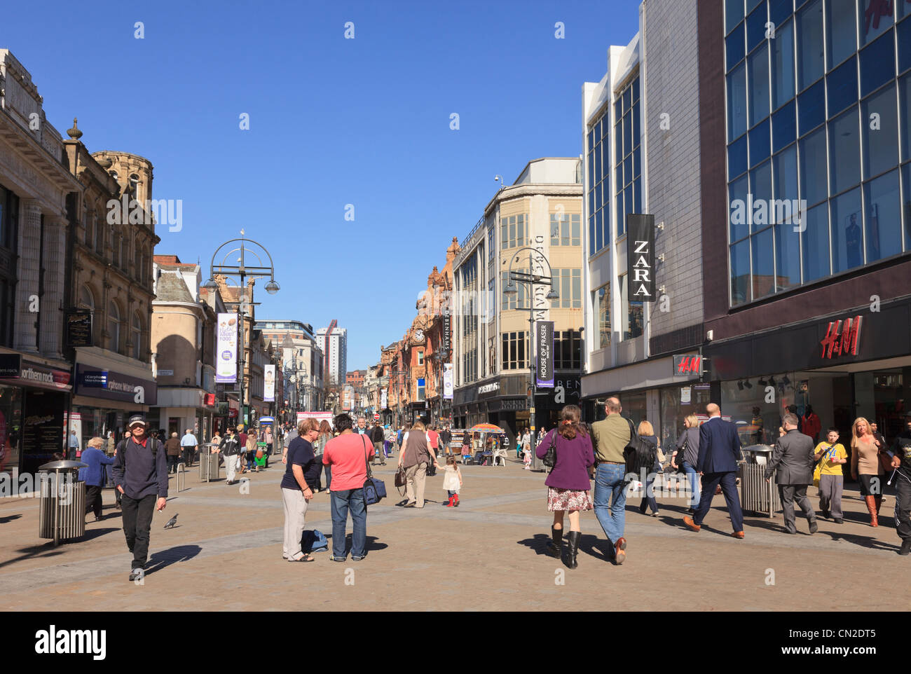 Busy main high street scene with people shopping in the city centre pedestrian precinct. Briggate, Leeds, West Yorkshire, - Stock Image