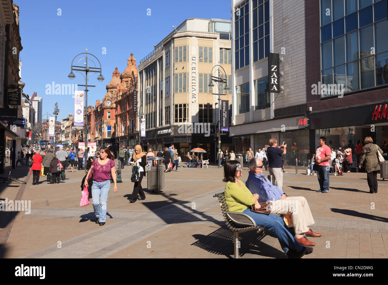 Busy pedestrian main high street scene with people shopping in city centre on Briggate, Leeds, West Yorkshire, England, - Stock Image
