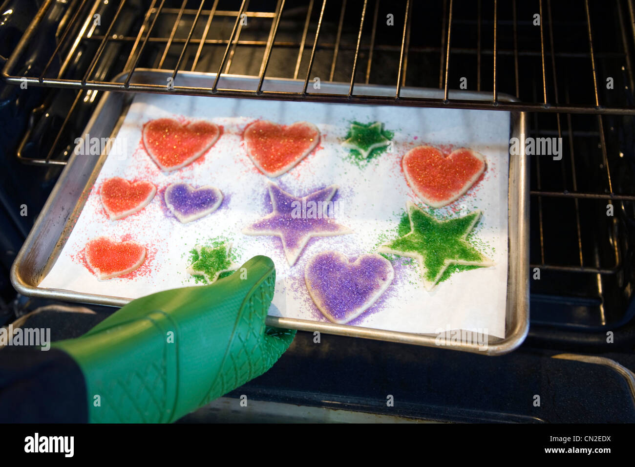Pan of Sugar Cookies Being Placed in Oven Stock Photo