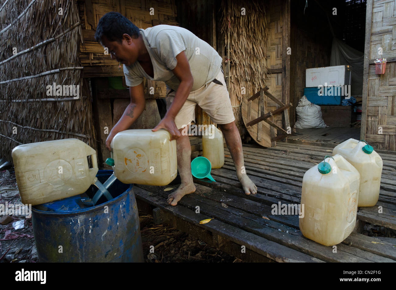 Drinking water supply from a rain pond. Yae Twin Saik village. Irrawaddy delta. Myanmar. - Stock Image