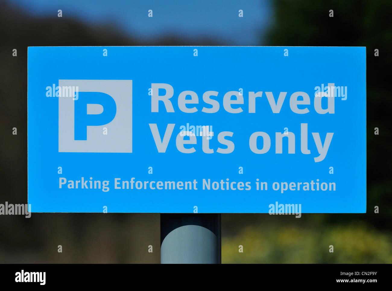 'Reserved Vets only'. Car parking notice at rail station. Grange-over-Sands, Cumbria, England, United Kingdom, - Stock Image
