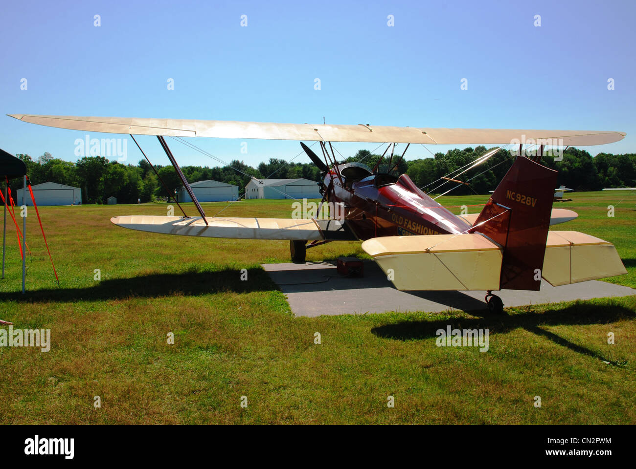 Biplane at an old fashioned airfield - Stock Image
