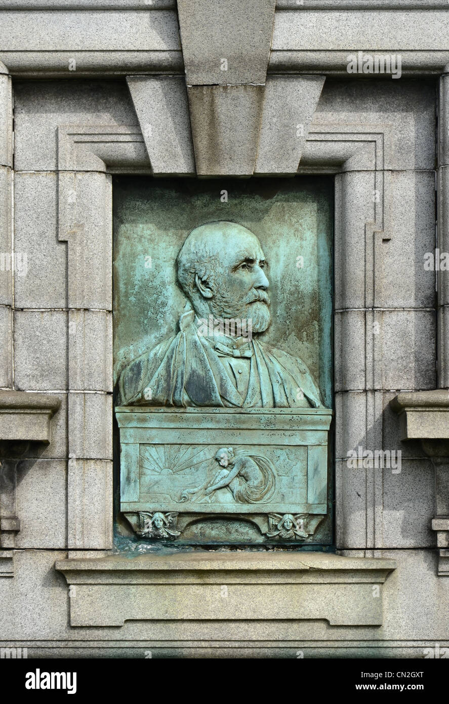 The art nouveau portrait panel on the tomb of Walter MacFarlane of the Saracen Foundry at the Glasgow Necropolis. - Stock Image