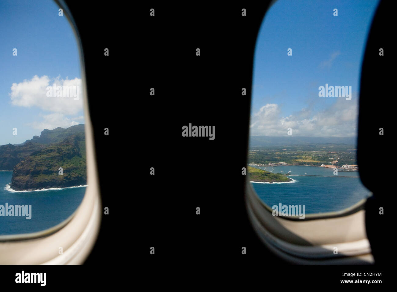 View of tropical island through airplane window - Stock Image