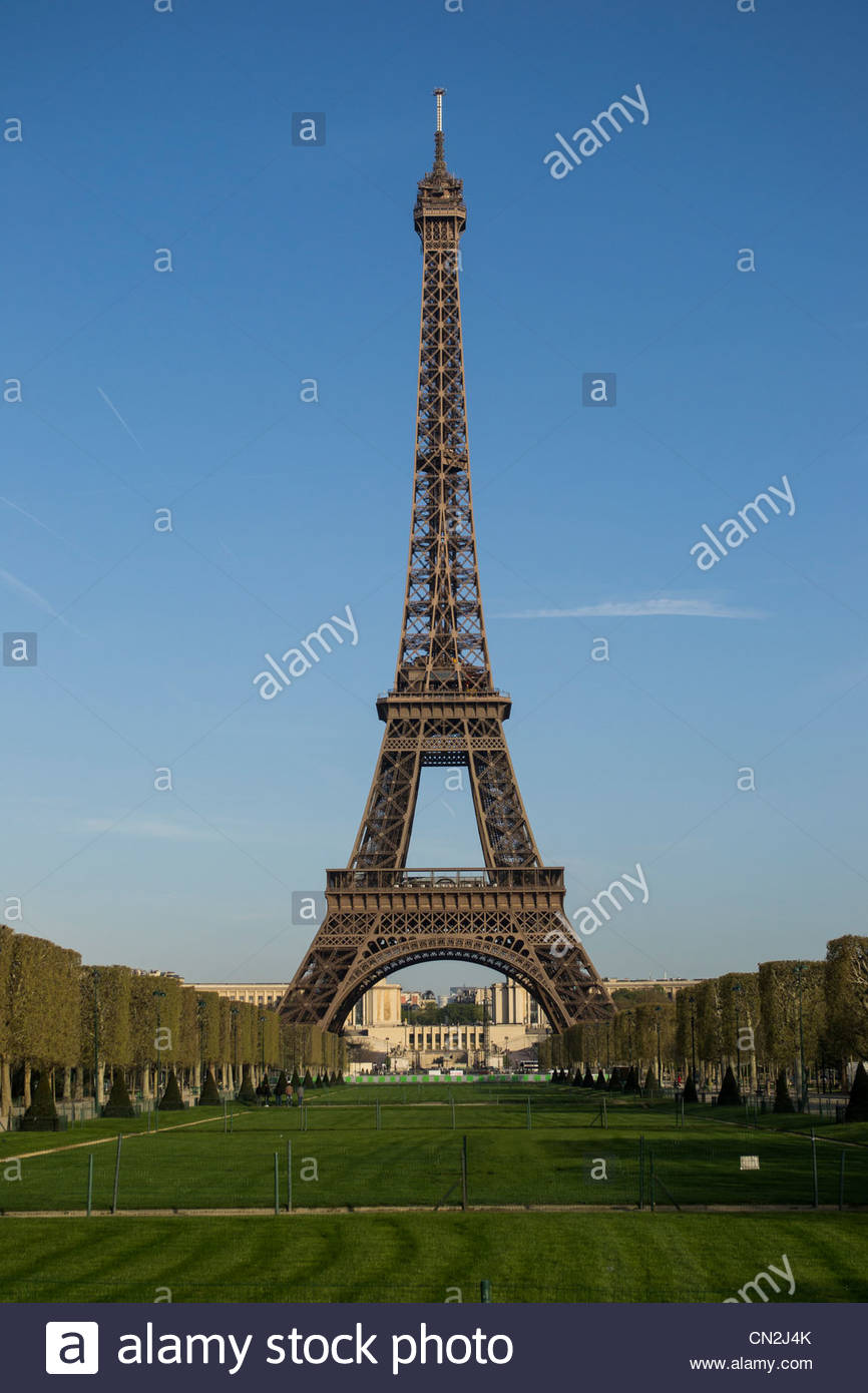 The Eiffel Tower from the Champ de Mars on a cloudless, spring morning - Stock Image