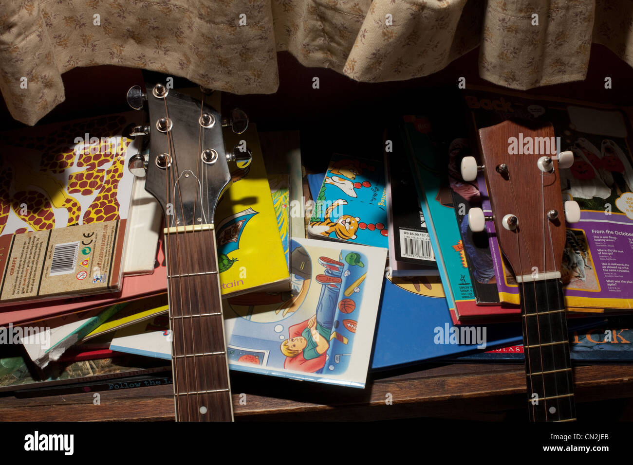 Guitars and children's books - Stock Image