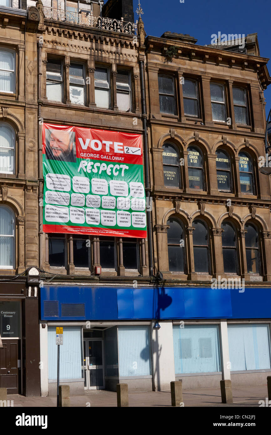 A Respect Party poster on a Bradford building, written in Slovak, Urdu and English. - Stock Image