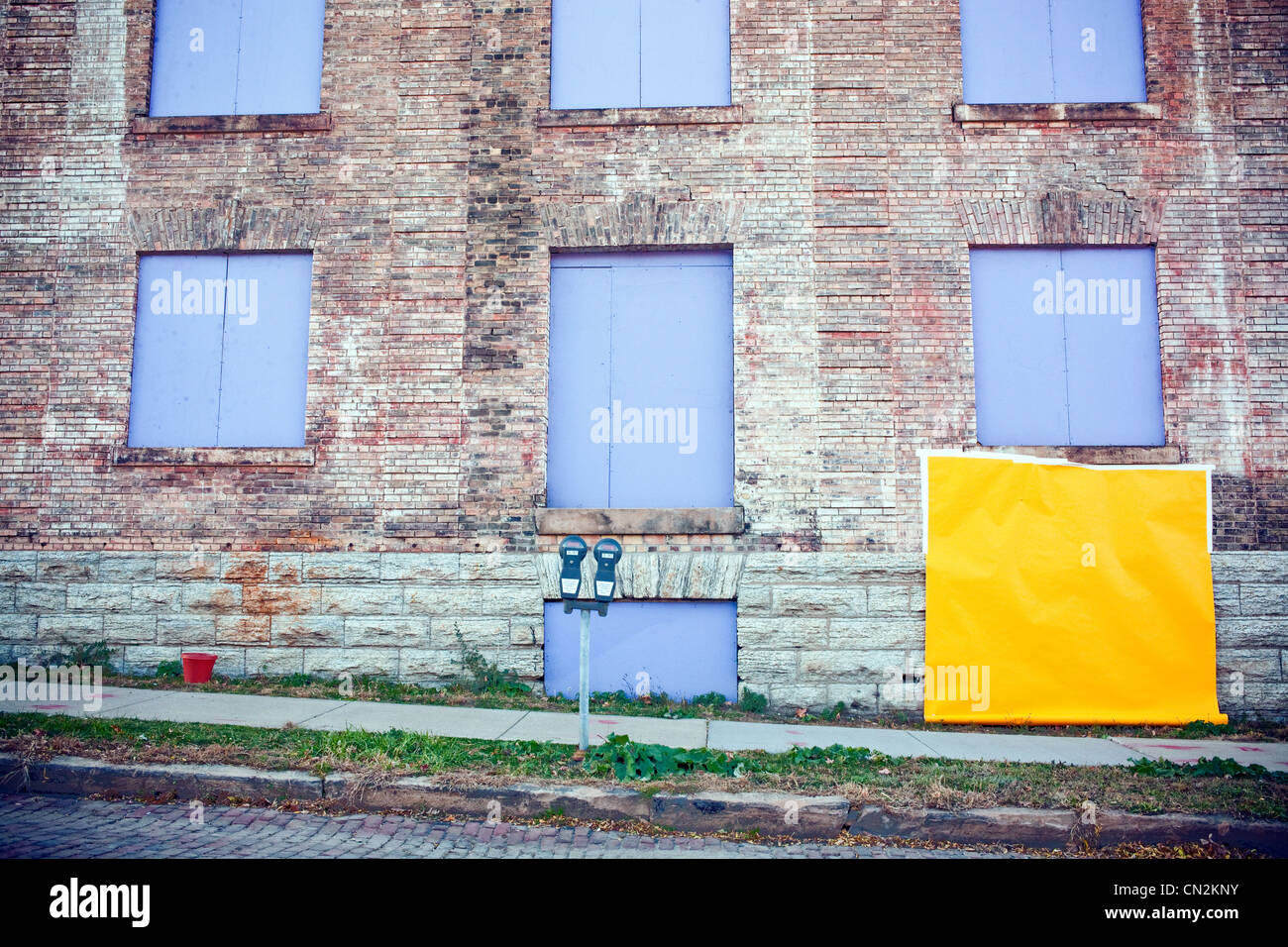 Yellow paper covering window Stock Photo
