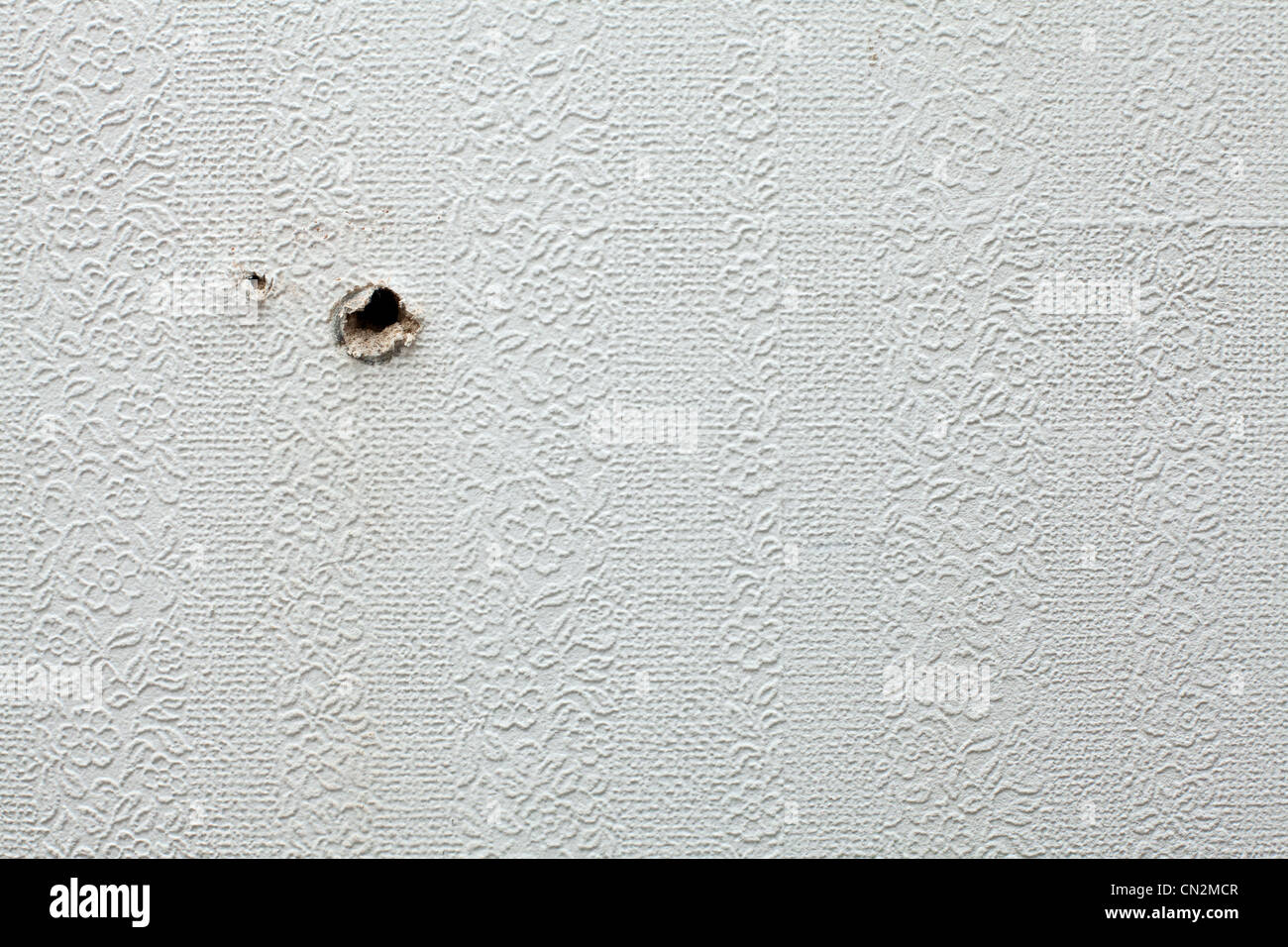Holes in wall - Stock Image