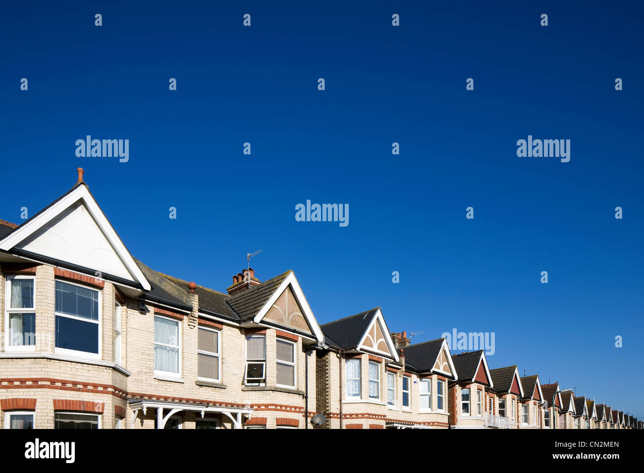 Street of houses and blue sky Stock Photo