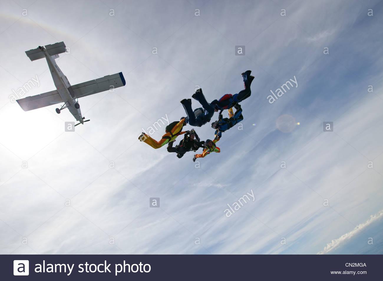 Formation skydiving over Saanen, Bern, Switzerland - Stock Image